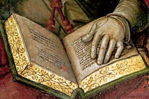 detalle de un cuadro de Santa Teresa de Jesús con un libro