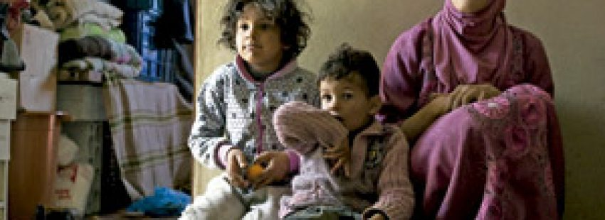 madre e hijos refugiados en Siria