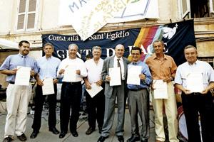 secuestrados europeos en Colombia, después de su liberación en 2002, visitan la Comunidad de Sant'Egidio en Roma