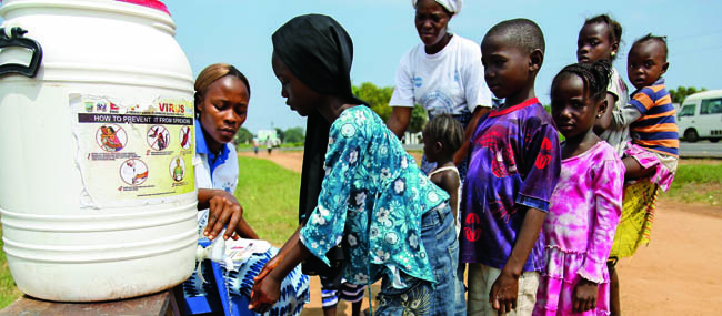 Children encouraged to wash hands at Ebola sensitization program in Liberia