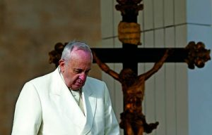 Pope Francis passes crucifix during general audience in St. Peter's Square