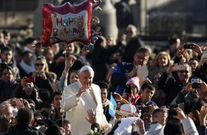 Balloon offers birthday wishes to Pope Francis as he arrives to lead general audience in St. Peter's Square at Vatican