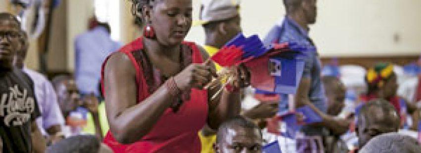 inmigrantes haitianos en Brasil en la fiesta de la bandera